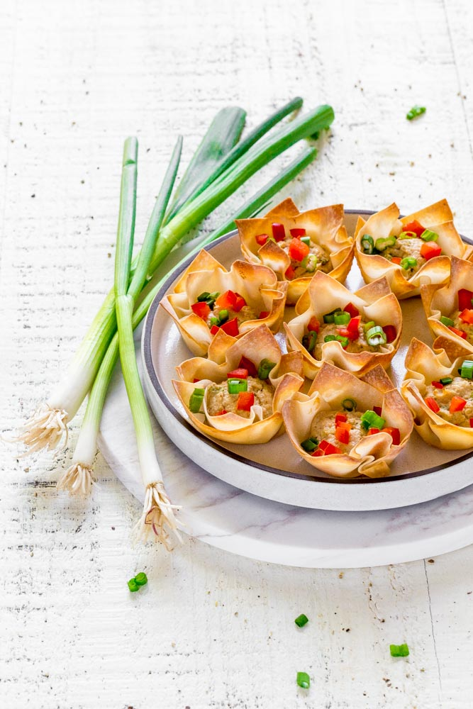 Baked wonton cups filled with a delicious crabmeat mixture.