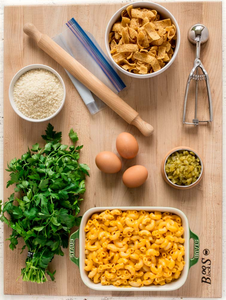 Ingredients for mac and cheese bites laid out on a maple John Boos Board.