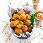 Mac and Cheese Bites sprinkled with chopped parsley.