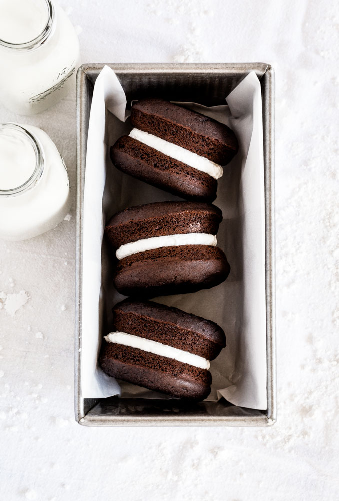Three whoopie pies displayed on their sides within a USA baking pan.