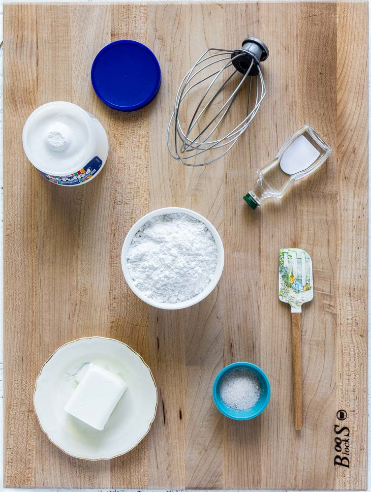 Ingredients for whoopie pie filling on a wooden work surface
