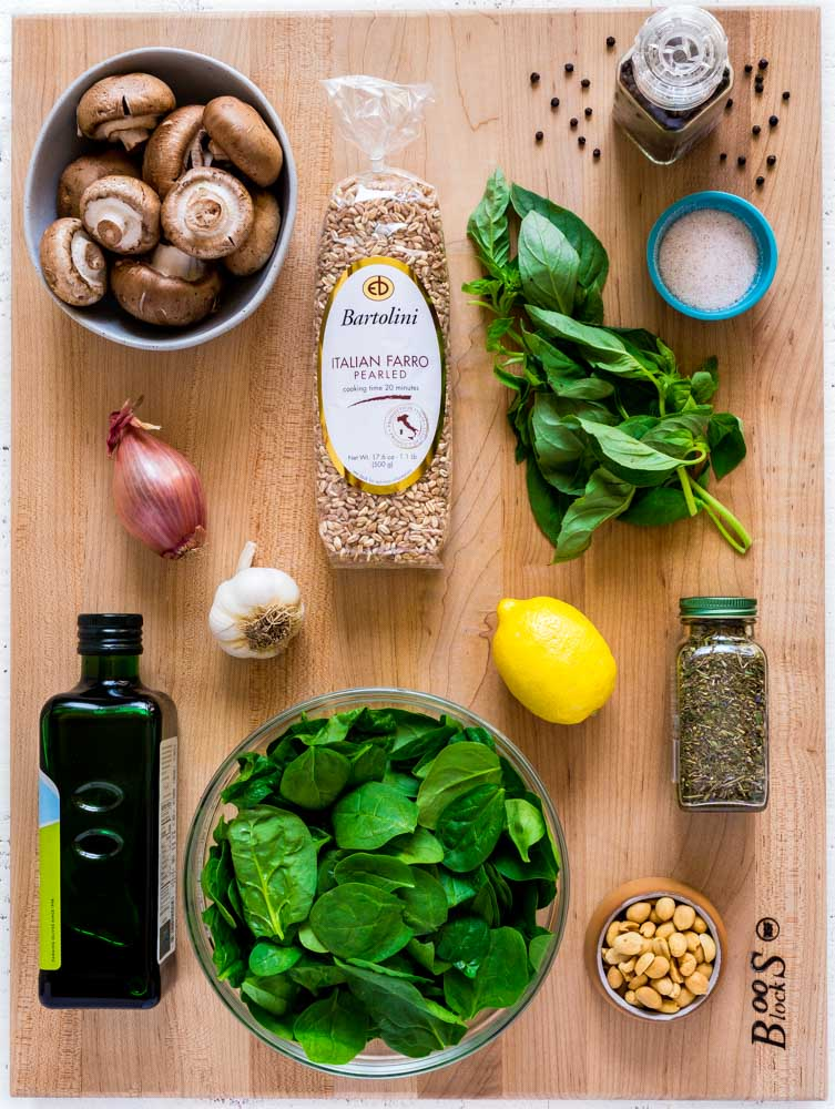 Ingredients for Farro Risotto laid out on a wooden block.