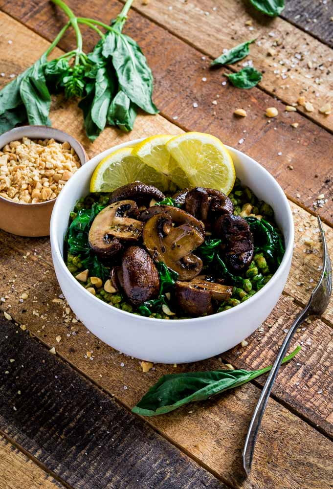 Farro Bowl garnished with lemon, roasted mushrooms, and peanuts.