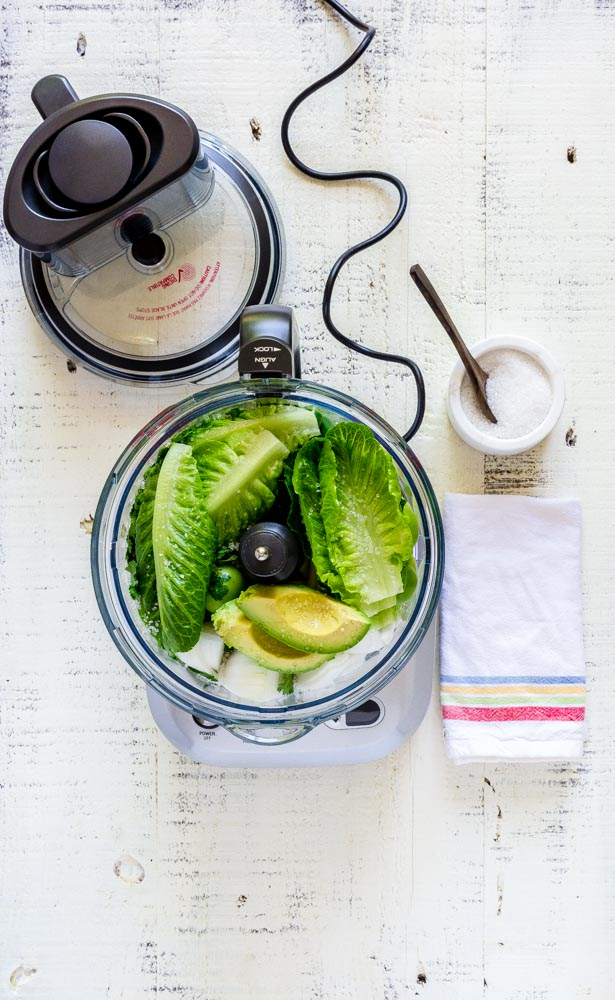 Raw ingredients for green salsa inside a Breville Sou Chef food processor.