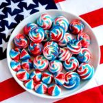 A plate of red, white and blue Meringue Cookies for the 4th of July.