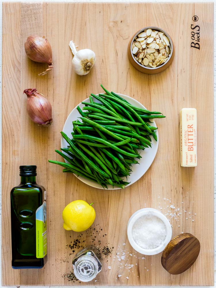 Ingredients for Green Beans Almondine laid out on an XL maple board.