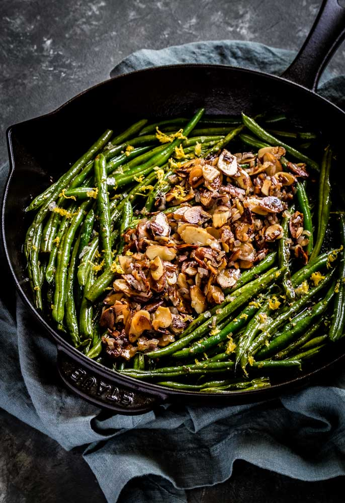 Sautéed French green beans garnished straight down the center with almondine.