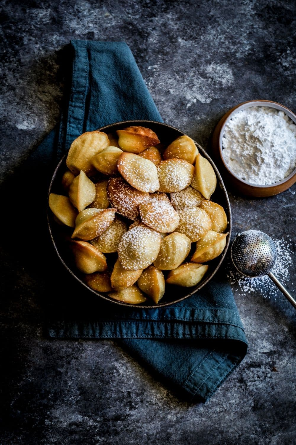 Iconic French Madeleines: golden blonde, lightly dusted with powdered sugar.