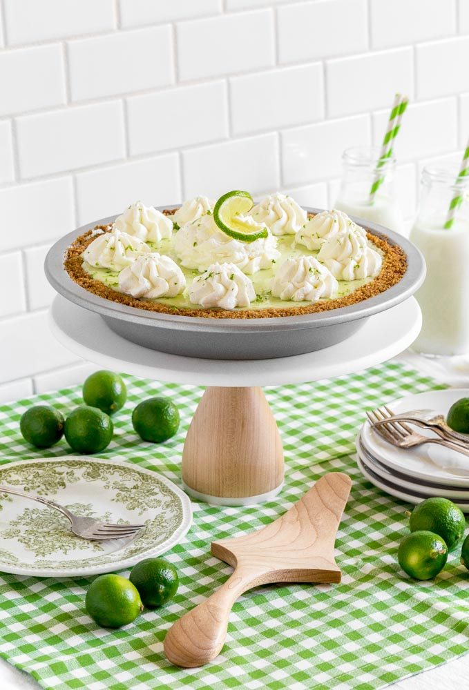 A green and white dessert table featuring Key lime pie.
