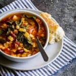 Minestrone soup in a small rustic bowl.
