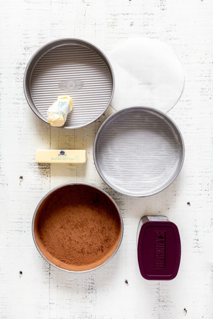 How to prepare 3 cake pans for baking a super moist chocolate cake.