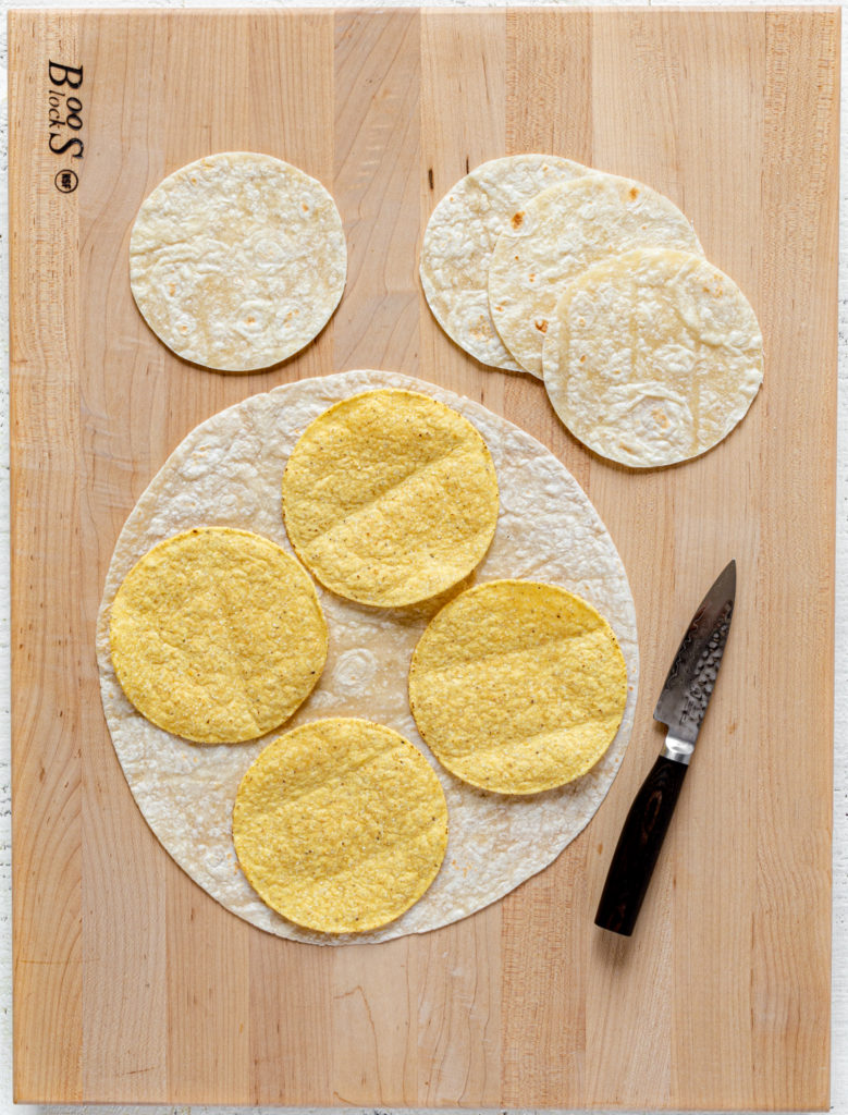 Image showing how to cut out small tortilla circles for crunchwrap recipe.
