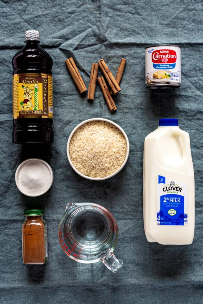 Ingredients for authentic Mexican horchata, AKA agua fresca, laid out on a tabletop.