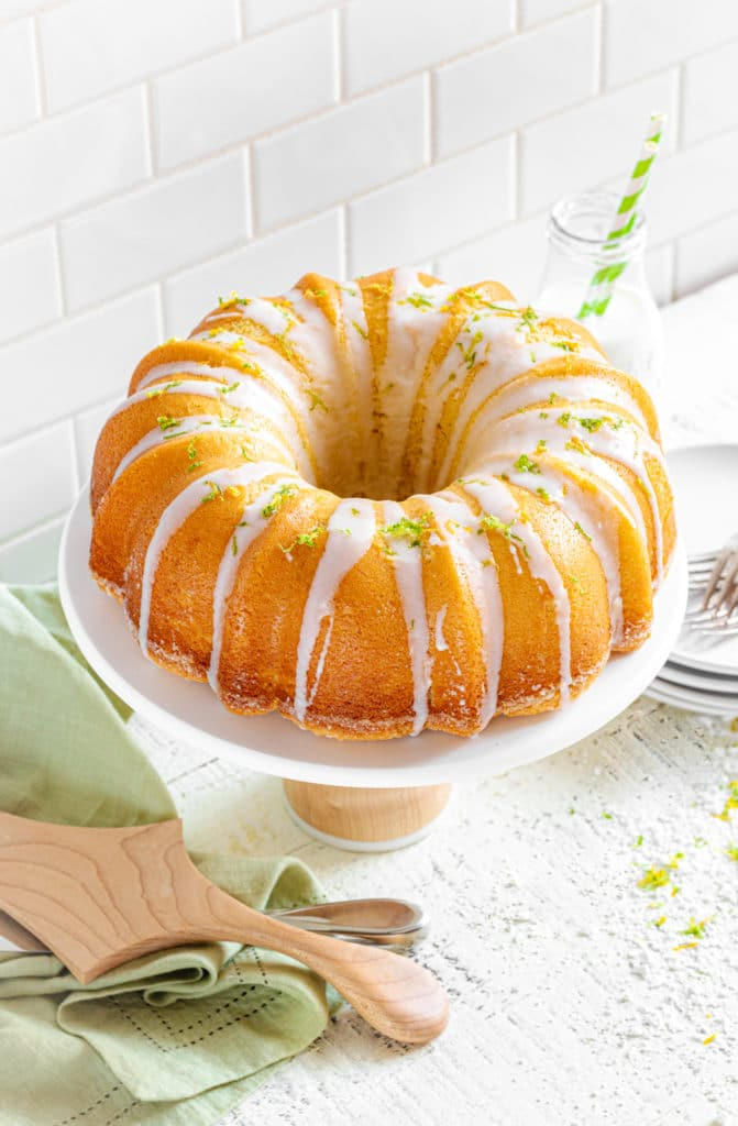 Starbucks lemon loaf copycat presented as a lemon bundt cake, glazed and garnished with citrus zest.
