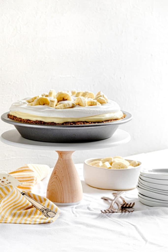 Banana Cream Pie, AKA banana pudding pie, on a brunch table dessert stand.