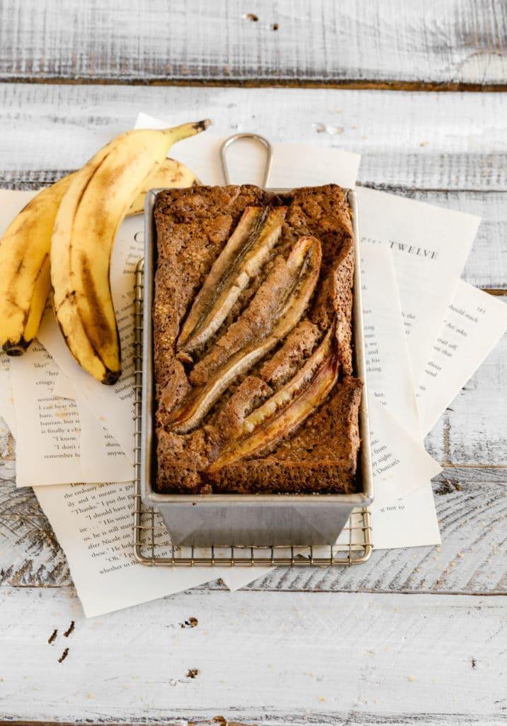Best Ever Banana Walnut Bread (Starbucks banana bread recipe) cooling in a metal loaf pan.