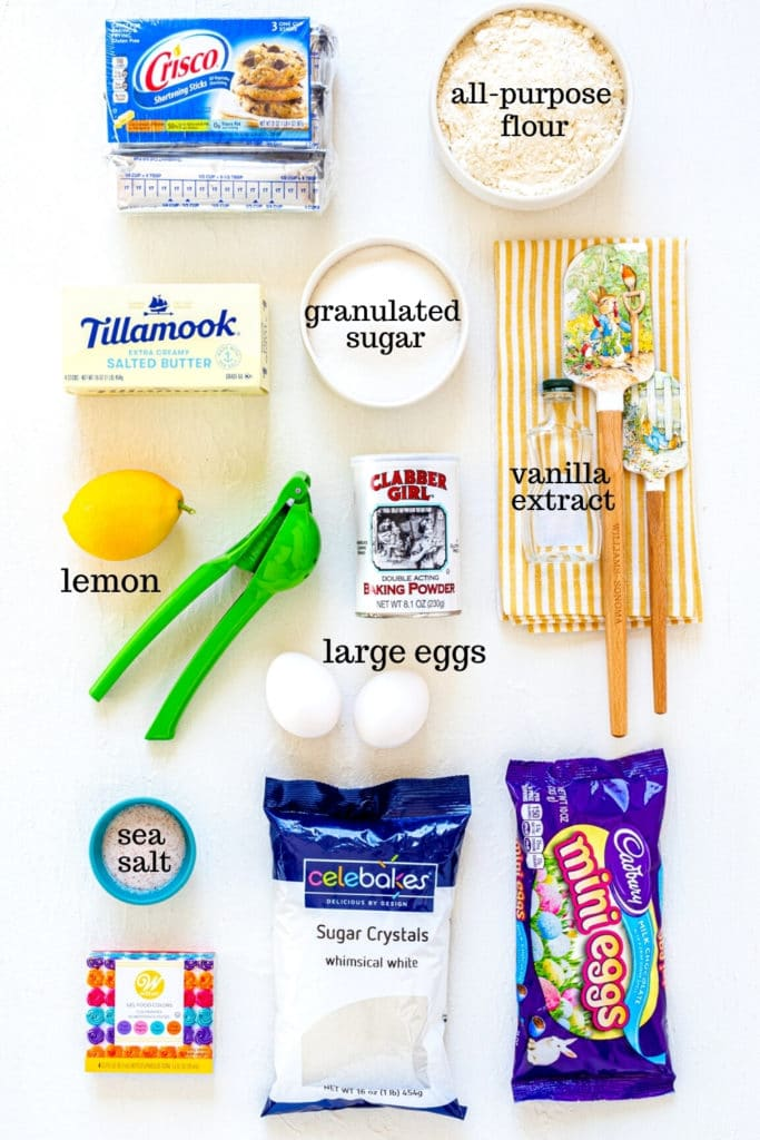 Ingredients for making Bunny Easter Sugar Cookies on a white tabletop.