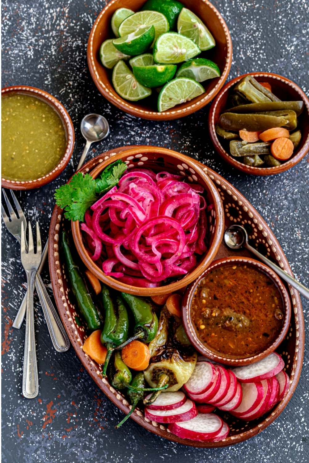 Mexican pickled onions served on a rustic clay condiment tray bought here in Mexico.