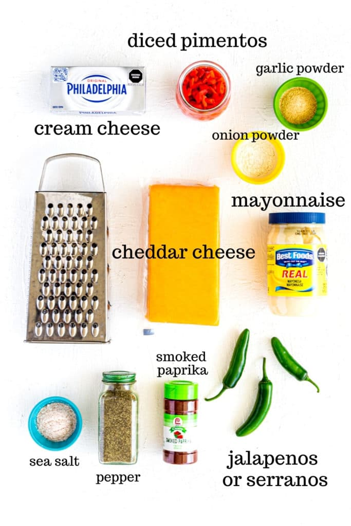 Ingredients for homemade jalapeno pimento cheese. This overhead image is taken on a bright-white surface.