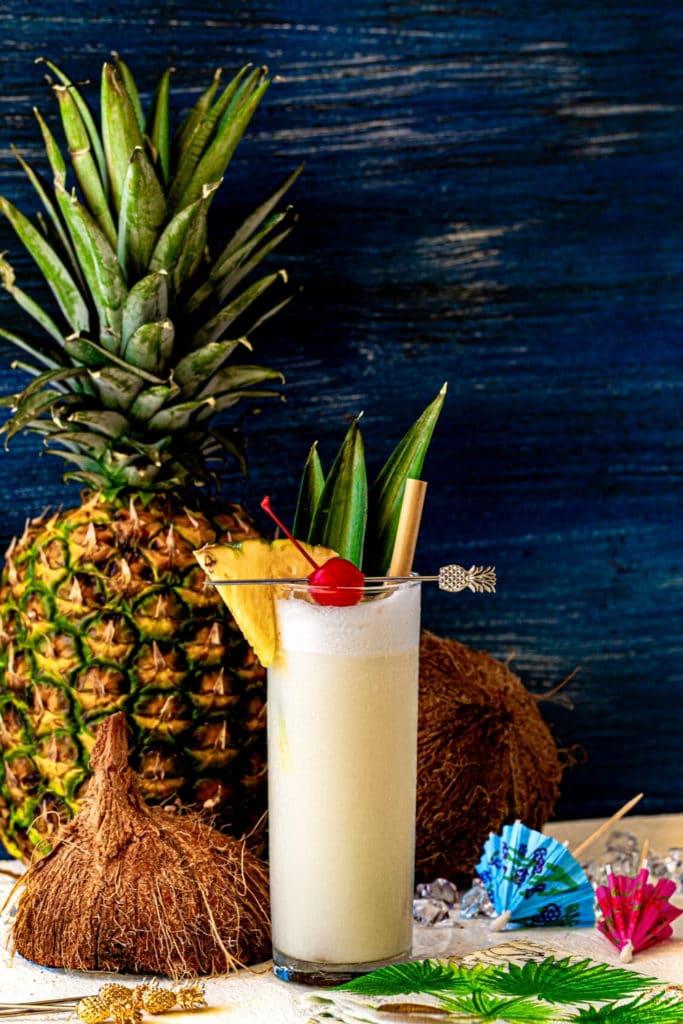 Original pina colada recipe served in a glass at a tropical beach bar.