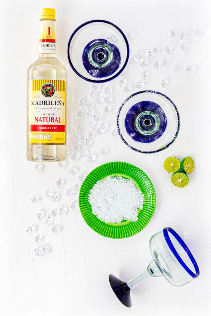 How to rim a Margarita glass with coarse salt.