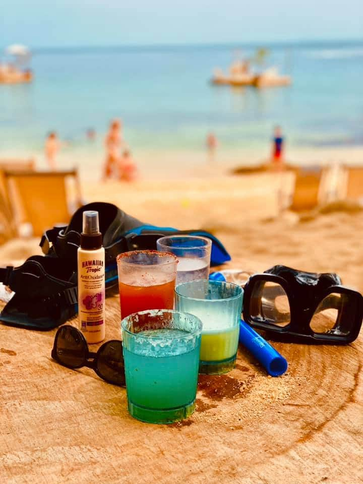 Tequila cocktails, including a Blue Margarita, on the beach in Mexico.