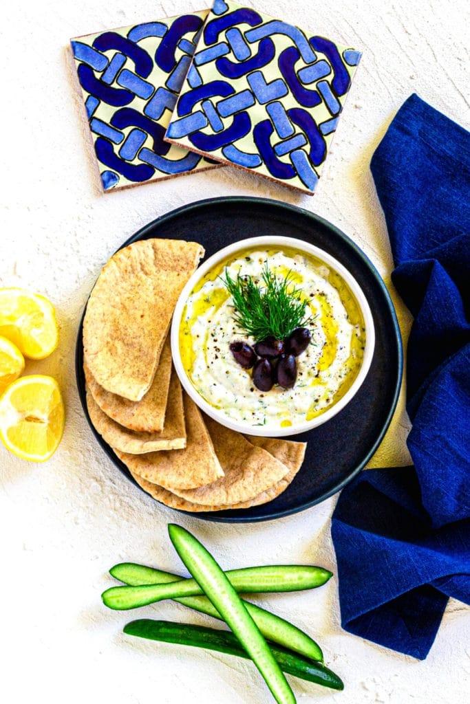 Tzatziki Gyro Sauce served with warm pita bread and Greek olives.