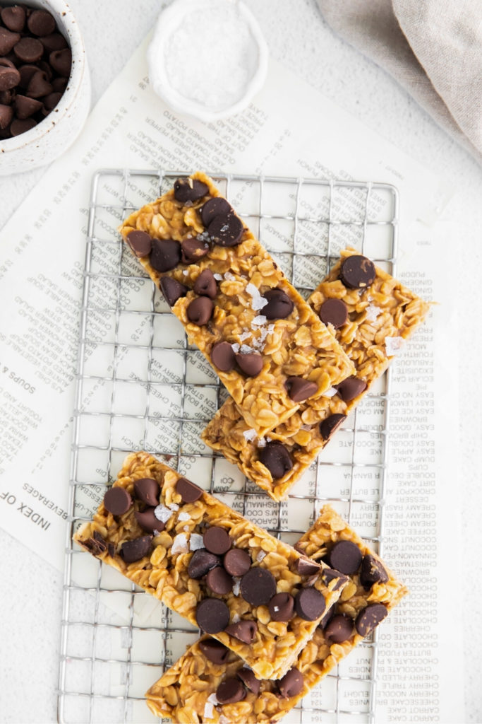 Overhead image of chewy chocolate chip granola bars on a wire rack for cooling.