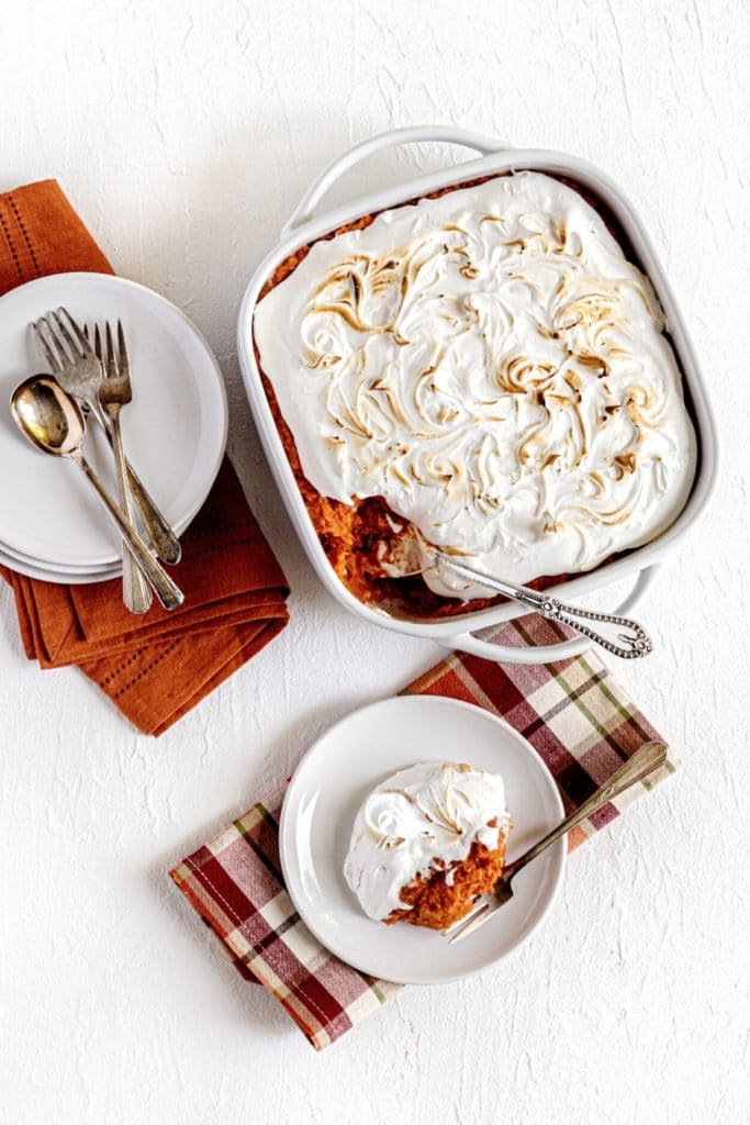 Sweet potato fluff casserole in baking dish and on a serving plate with fork.