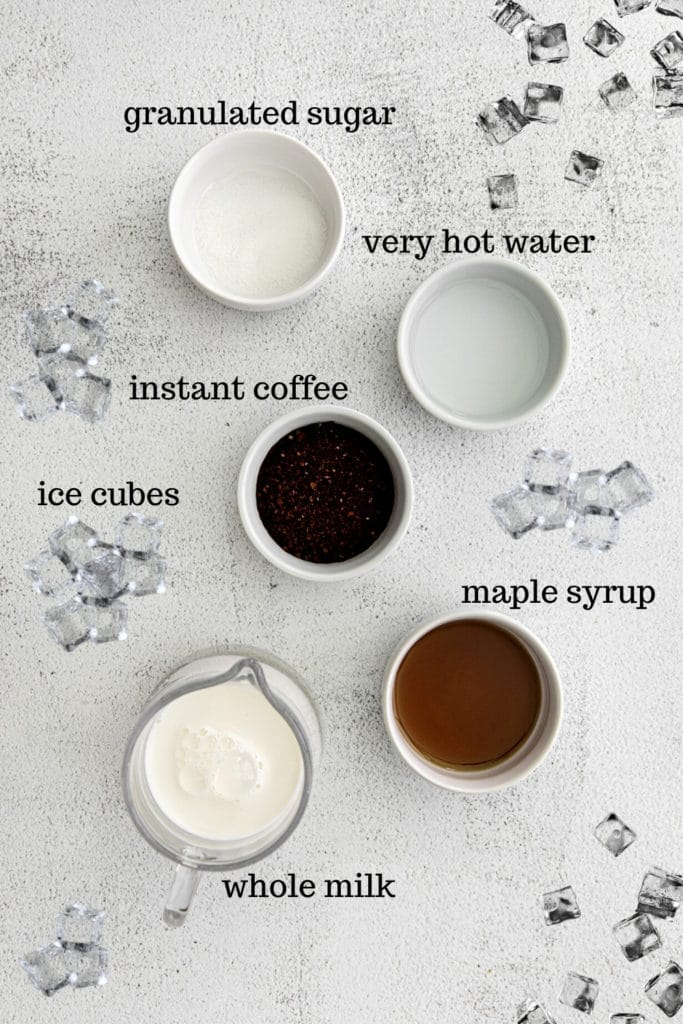 Ingredients for whipped maple coffee iced latte on light-grey countertop.