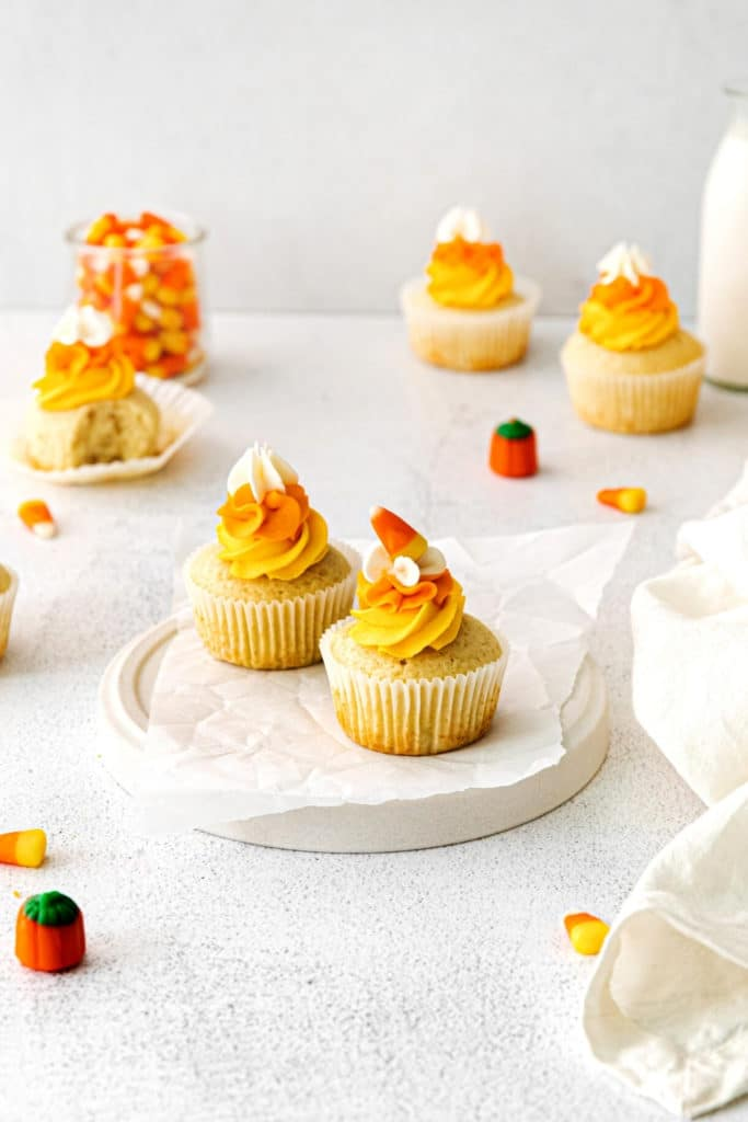 Halloween Dessert table with freshly-frosted candy corn cupcakes.