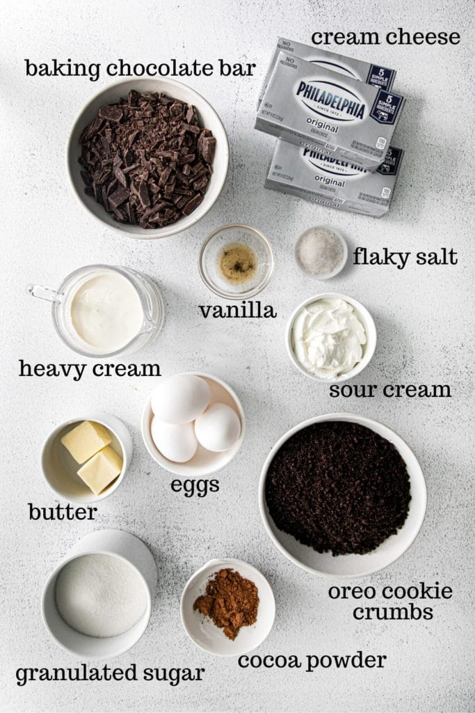Ingredients for making chocolate cheesecake bars with Oreo cookie crust.