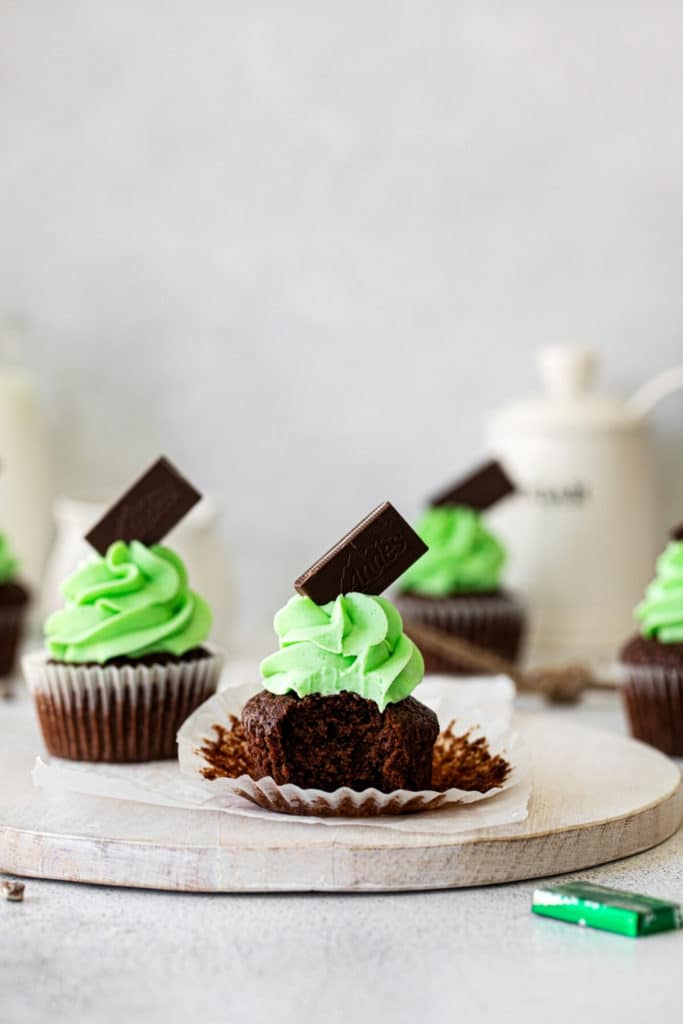Frosted mint cupcake with a bite taken out.