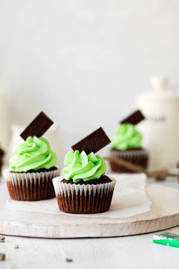 Andes Mint Chocolate Cupcakes on a white wooden board.