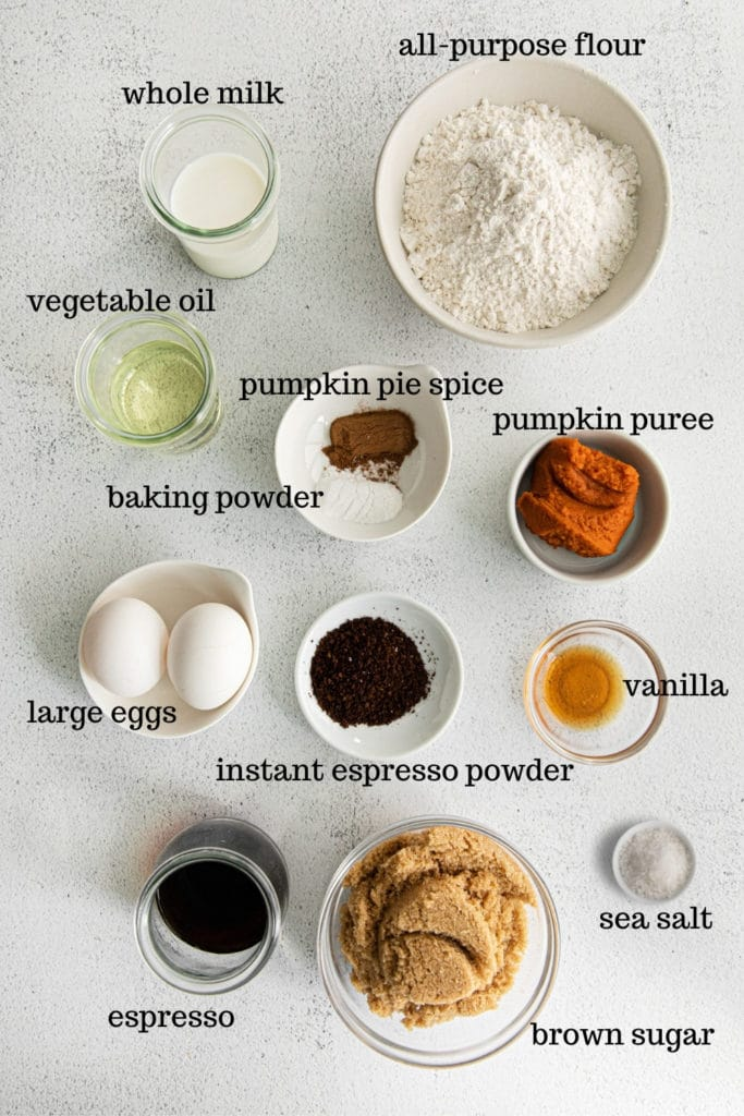 Ingredients for making pumpkin spice cupcakes from scratch.