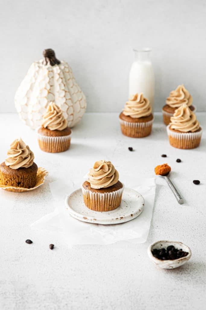 Swirls of vanilla espresso frosting on freshly-iced pumpkin spice latte cupcakes.