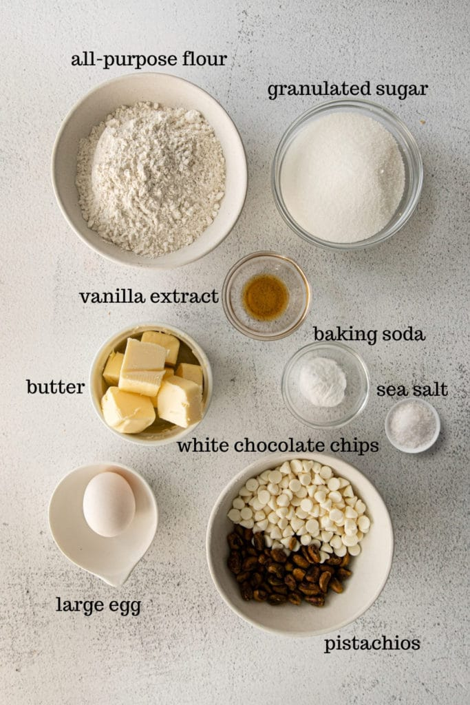Ingredients for white chocolate chip cookies with pistachios.